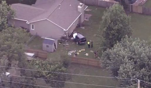 1 dead after vehicle crashes into western Shawnee home