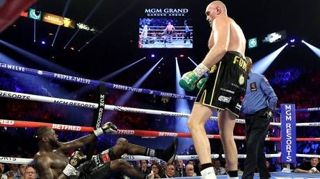 Tyson Fury stops Deontay Wilder in round seven to win WBC world heavyweight title in Las Vegas rematch
