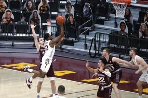 No. 21 Loyola holds on to beat Southern Illinois 60-52