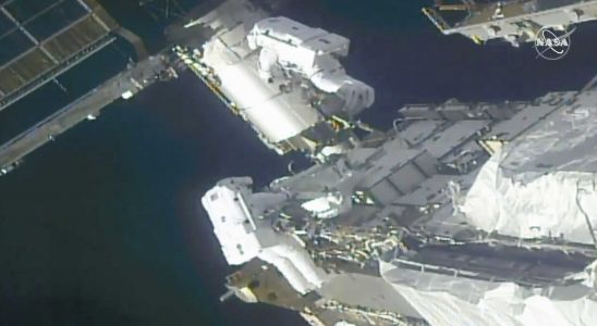 Spacewalking astronauts prep International Space Station for new solar panel wings