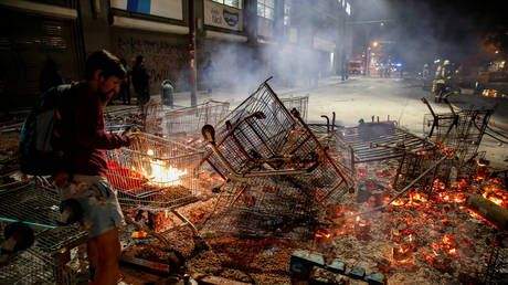 Chile military declares curfew, president vows to reverse transport fare hike after mayhem in Santiago