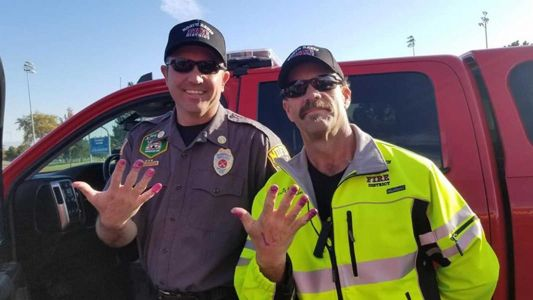 2 firefighters and a bottle of nail polish cheered up a scared little girl after a car accident