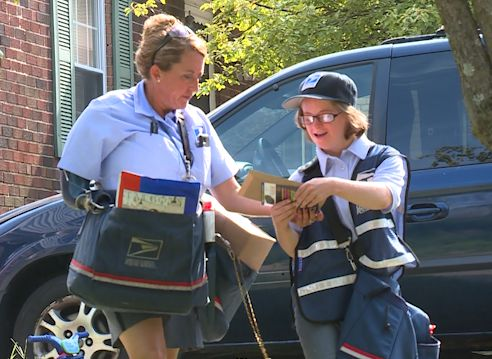 Woman with Down syndrome fulfills dream of becoming mail carrier