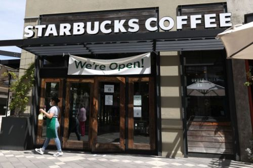 Starbucks to mandate facial coverings in all company-owned cafes starting July 15