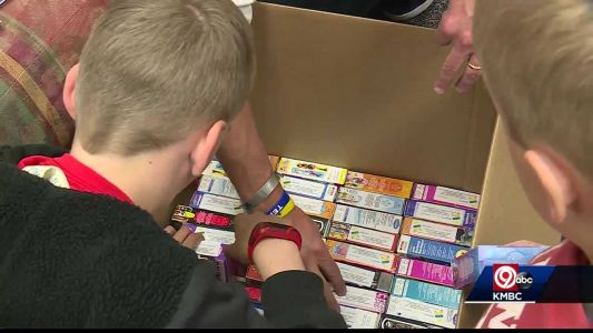 Olathe students help pack boxes of bandages to send to hospitals