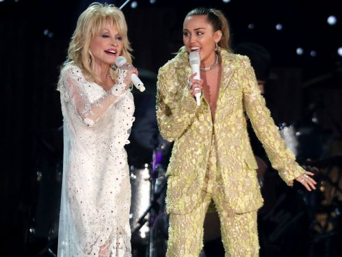 Dolly Parton is Miley Cyrus' godmother. Here's the story behind their relationship