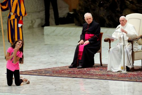 Pope lets sick girl clap, dance on stage during speech