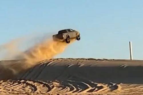 Truck and SUV catch air in epic sand dune jump