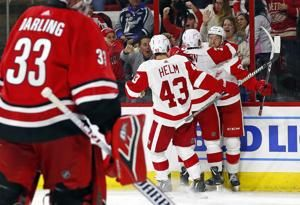 Mantha scores twice, Red Wings top Canes 4-3 in shootout