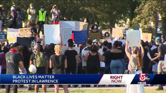Diverse crowd gathers in Lawrence with message of racial equality, peace