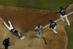 Dodgers charged with 2nd error on wild G4 play for Rays win