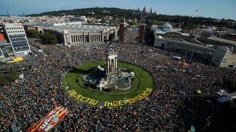 Tens of thousands rally in Barcelona to back independence on Catalan holiday