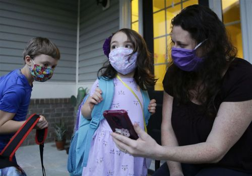 Parents struggle as schools reopen amid coronavirus surge
