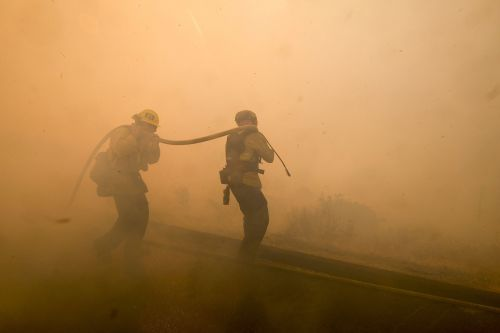 Rainstorm may give California firefighters break from battling wildfires