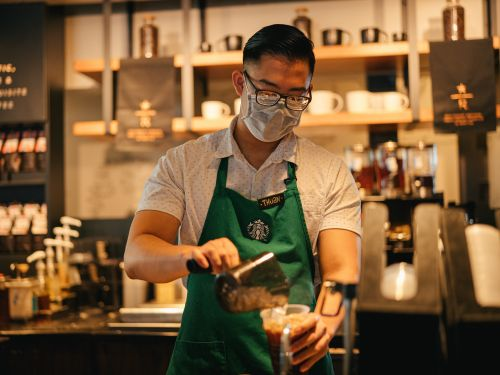 'Exhausted' Starbucks workers are forced to choose between reduced hours or unpaid leave, as the coffee giant adjusts to a new normal