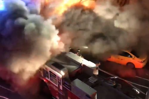 Huge inferno tears through Queens strip mall, injuring 12 people