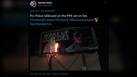 Portland protesters leave 'Kill the president' message on police union building & set fire to pro-cop billboard