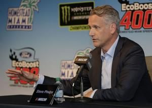 The Latest: MJ attending NASCAR finale, pulling for Hamlin