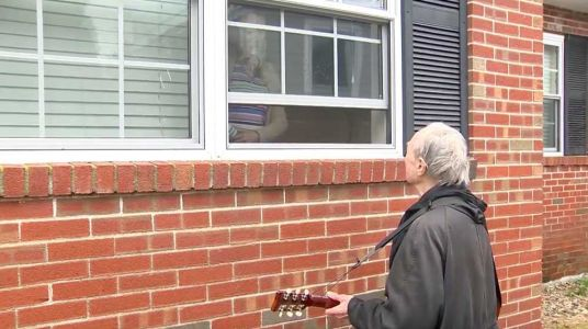 Window serenades and drive-by concerts: How people are staying connected despite coronavirus