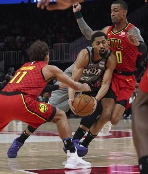 Collins, Reddish power Hawks' offense in win over Brooklyn