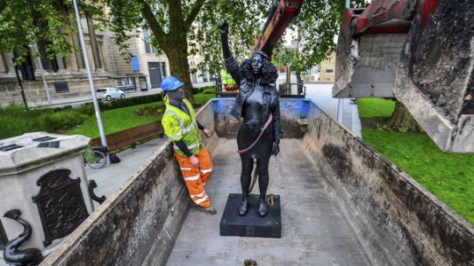 Statue Of Protester Is Removed In England, One Day After Replacing Slave Trader
