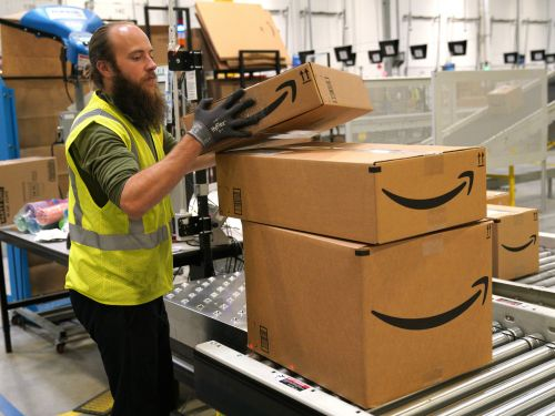 Amazon's push for a $15 minimum wage is a new weapon in the company's battle against Walmart