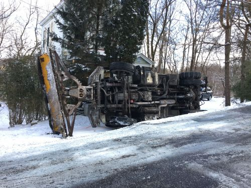 Driver hospitalized after salt truck overturns in Pittsburgh