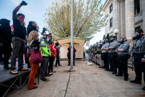 North Carolina voter rally ends with pepper spray, 8 arrests