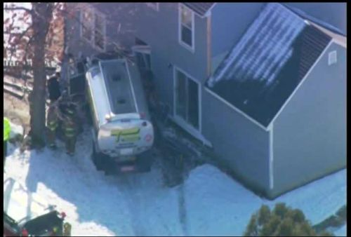 Raw video: Oil truck slams into home in Manchester