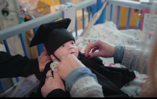 Baby celebrates heartwarming 'graduation day' from NICU with cap and gown