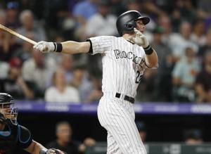 McMahon hits 2 homers as Rockies beat Marlins 11-4