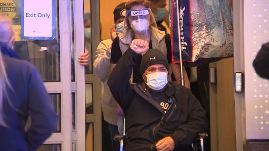 Video: Boston police detective leaves hospital after COVID-19 battle