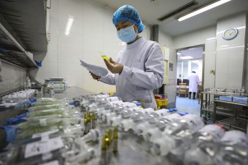 Chinese scientists say coronavirus illness symptoms peaked on February 1 - but they warn that the epidemic could 'rebound'