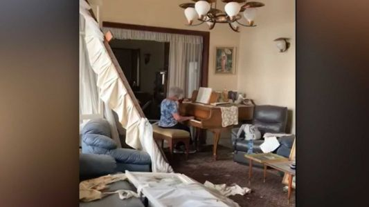 A grandmother played 'Auld Lang Syne' on a piano in her destroyed home after the Beirut explosion