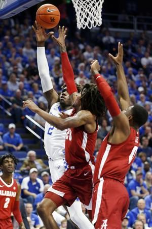 Kentucky forward Kahlil Whitney leaving the No. 15 Wildcats