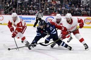 Jets net 3 goals in 2-minute span, deal Detroit 12th loss