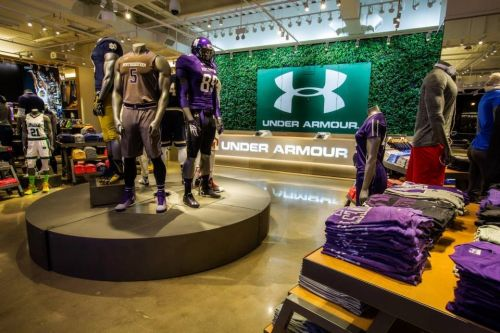 Under Armour surges as much as 7% after Raymond James upgrade