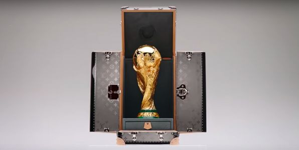 The World Cup trophy has its own customised and exclusive Louis Vuitton case, and it's being protected by 2 guards