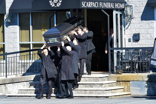 Slain mob boss Frank Cali laid to rest - as authorities look on