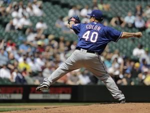 Colon shakes off liner to stomach, Rangers beat Mariners 5-1