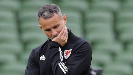 Manchester United wing legend Ryan Giggs charged with assaulting two women as Wales announce he will NOT lead team at Euros