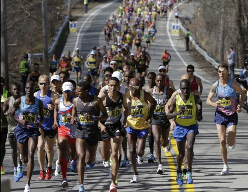 Boston Marathon's plan to hand out 70K medals roils runners