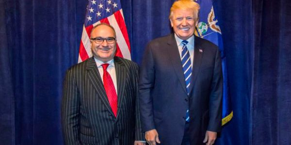 The wild story of how a convicted pedophile got his picture taken with Trump