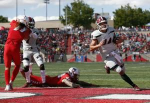 Tuioti leads New Mexico past New Mexico State 55-52