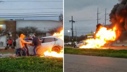 Heroic bystanders rescue woman from burning car
