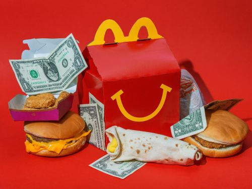 McDonald's is doubling down on deals and inexpensive breakfast to win over budget shoppers as the gap between rich and poor grows in America