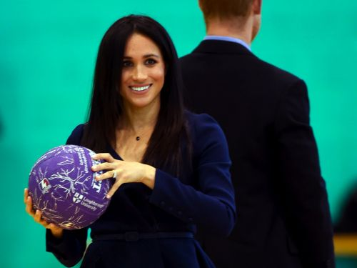 Meghan Markle wore a $2,290 Oscar de la Renta blouse with heels to throw around a basketball