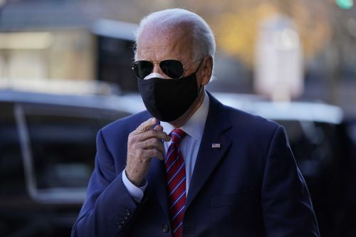 Doctor says Biden sprained a foot while playing with his dog