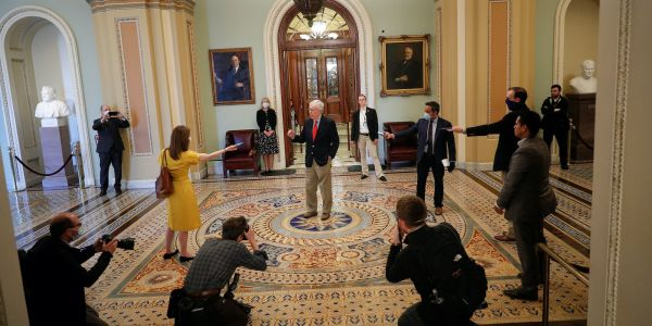 Surreal photos show Mitch McConnell speaking to mask-clad reporters who are spread at least 6 feet apart due to coronavirus