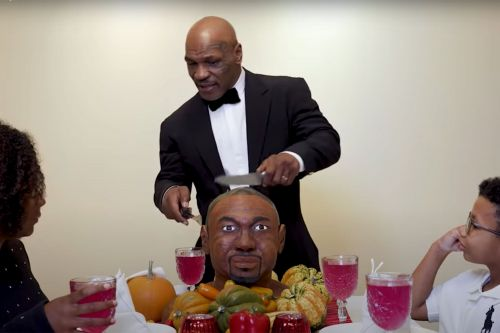 Mike Tyson eats ear off Roy Jones Jr. cake ahead of exhibition bout